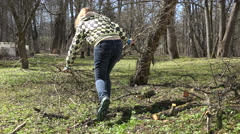 Gardener woman pick pruned fruit tree branches and carry. 4K Stock Footage