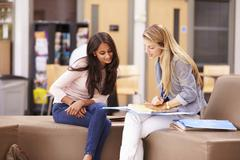 Female College Student Working With Mentor Stock Photos