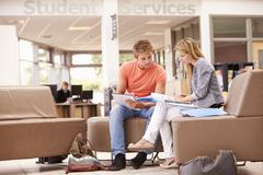 Male College Student Working With Mentor - stock photo