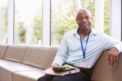 Portrait Of Male College Tutor With Digital Tablet Stock Photos