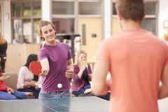 College Students Relaxing And Playing Table Tennis Stock Photos