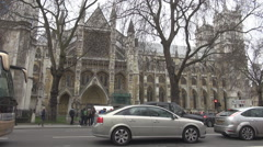 Cars move on street near Westminster Abbey, british cityscape in London, traffic Stock Footage