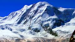 Snow mountain at sun dawn Stock Footage
