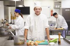 Students Training To Work In Catering Industry - stock photo