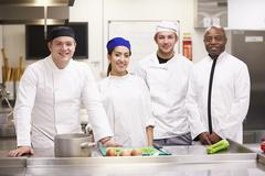 Portrait Of Teacher With Students In College Catering Class Stock Photos