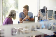 Mature Students Working In College Breakout Area - stock photo