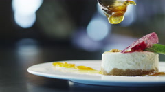 Chef is Garnish Ice Cream Dessert with Jam in Luxury Restaurant Stock Footage