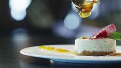 Chef is Garnish Ice Cream Dessert with Jam in Luxury Restaurant - stock footage