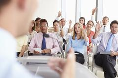 Delegates Asking Question At Business Conference Stock Photos