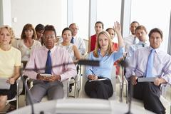 Delegate Asking Question At Business Conference Stock Photos