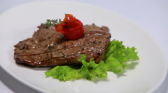 Veal steak rotating On White Background Stock Footage