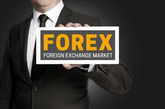 Forex sign is held by businessman - stock photo