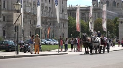 ULTRA HD 4K Romantic horse chariot Vienna old town medieval heritage tourism day Stock Footage