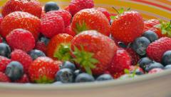 Mix of wild berries in the bowl Stock Footage