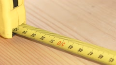 Tape measure, roulette reeling, slow motion Stock Footage