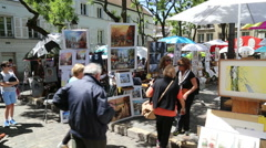 Paintings on painters corner at the Montmartre - stock footage