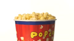 Popcorn in box on white, rotation Stock Footage