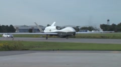 The MQ-4C Triton Unmanned Aircraft System Arrival Stock Footage