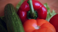 Slowmotion Of harvest of fresh vegetables and greens on the boards Stock Footage