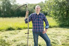 Man on  haymaking Stock Photos