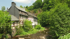 Little river in a typical village in Germany Stock Footage