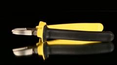 Mini cutters on black, rotation, rotation Stock Footage