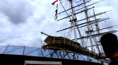 Cutty Sark, a tea clipper, docked at Greenwich. London -time lapse - stock footage
