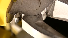 Part of wire cutters with yellow, gray handle on black, reflection,  macro Stock Footage