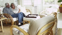 Happy senior black couple sitting on couch together - stock footage