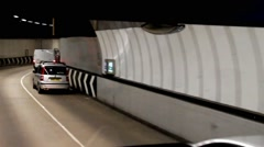 Cars in London road tunnel - stock footage