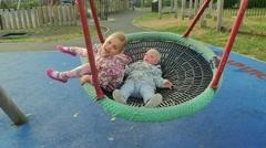 Children swinging on a swing Stock Footage