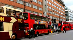 Tourists and locals in the famous Oxford Street near Primark shop at rush time Stock Footage