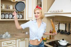 aggressive cook in a pan, on the background of the kitchen - stock photo