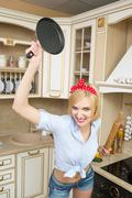 Aggressive cook in a pan, on the background of the kitchen Stock Photos