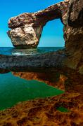 Stock Photo of Azure Window, famous stone arch of Gozo island in the sun in summer, Malta