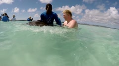 Antigua Caribbean Sea 223 how to hold a stingray correctly with hands Stock Footage