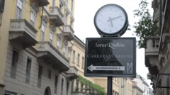 The clock on the street Monte Napoleone in Milan Stock Footage