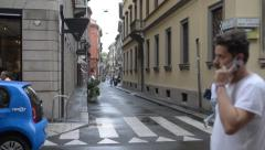 Milan city center. Vehicles and pedestrians walk and view windows. Stock Footage