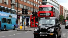 Unidentified  people rent taxi in the famous Oxford Street near Primark shop Stock Footage