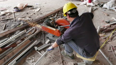 Worker Cutting Metal with a Power Saw on Construction Site - 4K Stock Footage