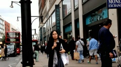 Tourists and locals in the famous Oxford Street near Primark shop Stock Footage