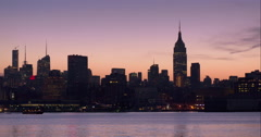 The midtown Manhattan skyline in the early morning with a purple sky above Stock Footage