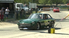 Motorsports, hillclimb launch green classic MGB GT Stock Footage