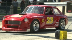Motorsports, hillclimb launch red MGB GT V8 powered Stock Footage