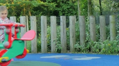 Young girl in the playground Stock Footage