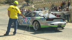 Motorsports, hillclimb launch silver RX7, 3-rotor powerful Stock Footage