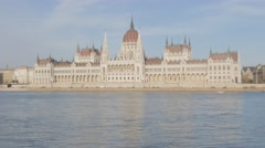 Famous Hungarian parliament building by the day located on river Danube banks Stock Footage
