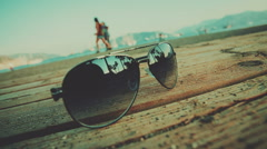 Displaying silhouettes of people prohadyat glasses on the beach Stock Footage