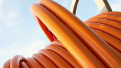 Zoom-out on orange cable on drum Stock Footage