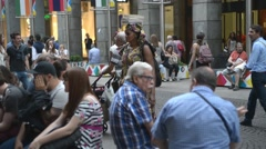 Dark-skinned african vendor of books in the center of Milan Stock Footage